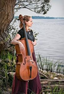 Marion with cello by tree